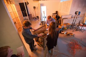 Production Designer, John Burgess, works on the generator